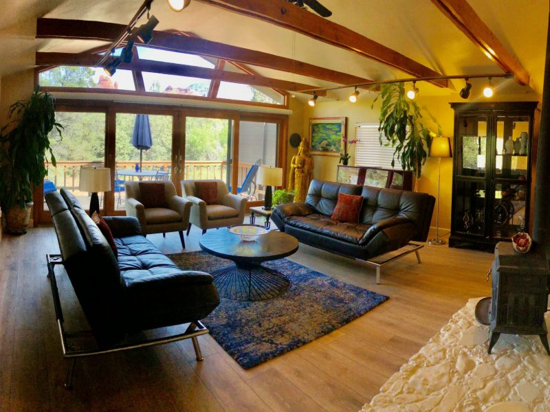The Forest Villa living room features a 16 foot wall of glass overlooking the Coconino National Forest.